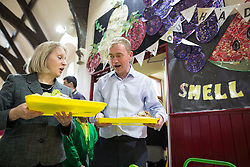 © Licensed to London News Pictures . 24/11/2015 . Oldham , UK .  Liberal Democrat leader TIM FARRON (c) and candidate JANE BROPHEY (l) eating school lunch whilst campaigning at St Thomas CofE Primary School in the seat of Oldham West and Royton , in a by-election triggered by the death of MP Michael Meacher . Photo credit : Joel Goodman/LNP