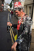 Covered in flour and water, a student celebrates the end of Finals (exams)  at Oxford University