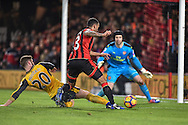 Arsenal Defender, Shkodran Mustafi (20) tackles AFC Bournemouth Forward, Callum Wilson (13) in the box during the Premier League match between Bournemouth and Arsenal at the Vitality Stadium, Bournemouth, England on 3 January 2017. Photo by Adam Rivers.