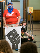 12 JUNE 2020 - DES MOINES, IOWA: A supporter of Black Lives Matter participates in a protest in front of the Governor's office in the Iowa capitol. About 75 activists from Black Lives Matter came to the Iowa State Capitol in Des Moines Friday to talk to Iowa Governor Kim Reynolds. They've been trying to meet with Gov. Reynolds all week. She made time for them Friday and met with 5 representatives of the organization without any media in the room. They wanted to talk to her about police violence against African-Americans and racial disparities in Iowa's justice system. While the 5 met with the Governor, the remaining activists picketed the hall in front of her office and chanted.     PHOTO BY JACK KURTZ