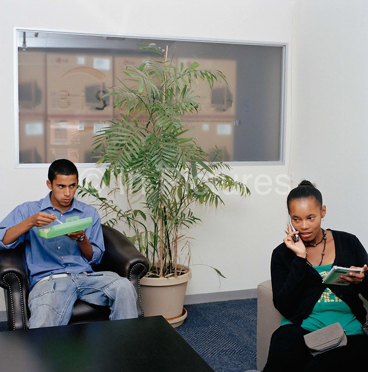 Lunchtime at a call centre in Cape Town in South Africa, From the series Desk Job, a project which explores globalisation through office life around the World.
