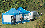 © Licensed to London News Pictures. 05/10/2014. Brentford, UK Police remove the body of Arnis Zalkains from Boston Manor Park today 5th October 2014. The body of a man, believed to be Latvian killer Arnis Zalkalns, was found in Boston Manor Park, Brentford, almost six weeks after the schoolgirl Alice Gross vanished.Arnis Zalkalns was prime suspect in the murder of 14-year-old Alice Gross.. Photo credit : Stephen Simpson/LNP