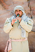 Middle East, Jordan, Petra, UNESCO World Heritage Site. Display Nabataean Lifestyle and customs. Man playing a flute