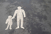 Parent and child painted figures on a path in London, United Kingdom.