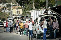 """Police Operations and Essential Services Personnel operating under lockdown period in Fish Hoek and Masipumelela in the Cape Peninsula, near Cape Town, Western Cape, South Africa, RSA Luyanda Lendile and his pavement hawker mate want me to throw them some money """"so we do not have to go and steal""""."""