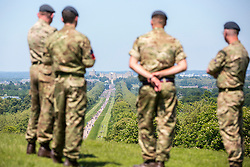 Members of the armed forces look at crowds gathered down the Long Walk at Windsor Castle for the wedding of Meghan Markle and Prince Harry.