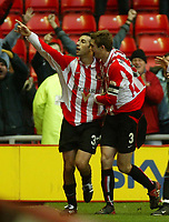 Photo. Andrew Unwin.<br /> Sunderland v Nottingham Forest, Nationwide League Division One, Stadium of Light, Sunderland 10/01/2004.<br /> Sunderland's Julio Arca (l) celebrates scoring his goal with teammate George McCartney (r).
