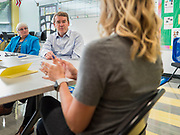 05 SEPTEMBER 2019 - DES MOINES, IOWA: US Senator MICHAEL BENNET (D-CO), center, and CELESTE KELLING, the school administrator, left, listen to teachers and staff at Jesse Franklin Taylor Education Center during an education roundtable Bennet hosted in Des Moines. Sen. Bennet is running for the Democratic nomination for the US Presidency in the 2020 election. Iowa traditionally hosts the the first election event of the presidential election cycle. The Iowa Caucuses will be on Feb. 3, 2020.             PHOTO BY JACK KURTZ