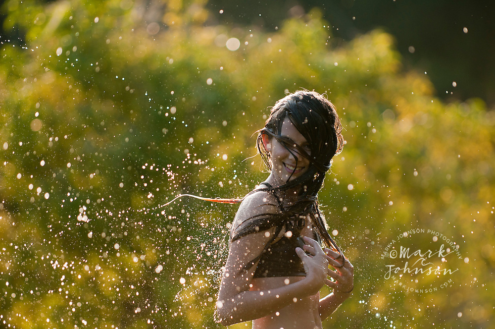 13 year old girl swinging her wet hair, Kauai, Hawaii people ****Model Release available