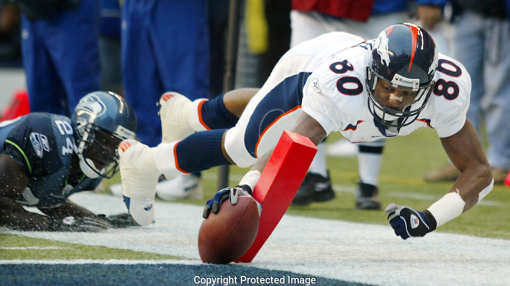 Denver Broncos' Rod Smith reaches in attempting to make a touchdown after catching a pass inside the two yard line.  (AP Photo/John Froschauer)