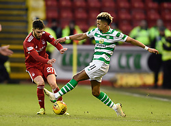 Celtic's Scott Sinclair (right) and Aberdeen's Connor McLennan battle for the ball during the Scottish Premiership match at Pittodrie Stadium, Aberdeen.