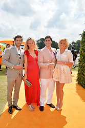 Left to right, JACK & KATE FREUD, ZAFAR RUSHDIE and his fiance NATALIE COYLE at the Veuve Clicquot Gold Cup Final at Cowdray Park Polo Club, Midhurst, West Sussex on 20th July 2014.