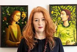 The legendary events and personal tragedies that marked the life of Mary, Queen of Scots will be the subject of a new exhibition in Edinburgh this autumn. Linger Awhile, which will open on 14 September at Arusha Gallery, will include 17 new oil paintings by Glasgow-based artist Helen Flockhart, focusing on the human side of the historical figure.<br /> <br /> Helen Flockhart (b.1963) is one of the finest and most distinctive Scottish artists of her generation. She often draws creative inspiration from esoteric and mythical sources, and her unique style combines intricate patterns, backdrops of lush foliage, and surreal scenes that appear suspended in time.<br /> <br /> Pictured: Helen Flockhart with O Elizabeth, 2018 and I see and Keep Silent, 2018