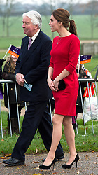 Duchess of Cambridge wearing a Catherine Walker red dress, attends the East Anglia's Children's Hospices (EACH) appeal launch at the Norfolk Showground in Norwich
