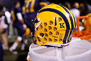 "A ""K"" sticker is worn on the Milpitas High School helmets in remembrance of head coach Kelly King's wife, who recently passed away, during a game against Fremont at Milpitas High School in Milpitas, California, on November 1, 2013. (Stan Olszewski/SOSKIphoto)"