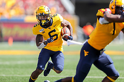 Sep 14, 2019; Morgantown, WV, USA; West Virginia Mountaineers running back Kennedy McKoy (6) runs the ball during the third quarter against the North Carolina State Wolfpack at Mountaineer Field at Milan Puskar Stadium. Mandatory Credit: Ben Queen-USA TODAY Sports