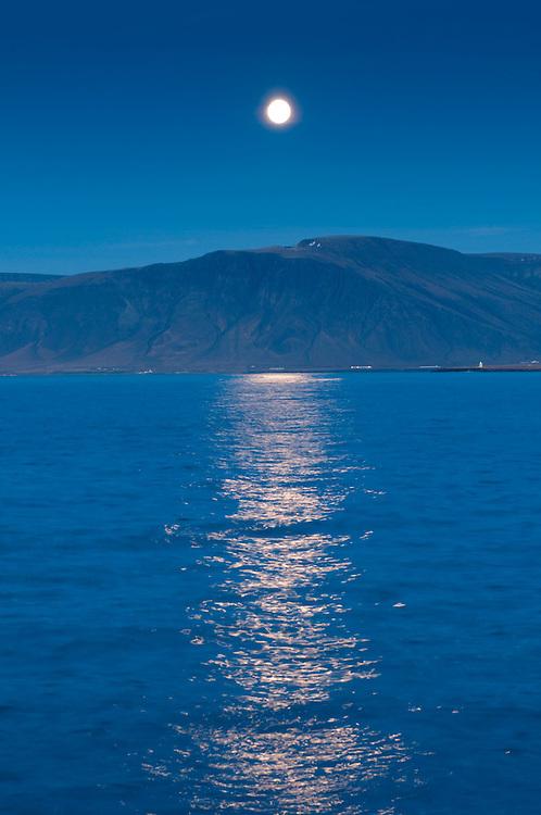Moon rise refelcting in sea, Reykjavik, Iceland.