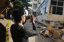 December 11, 2016 - Samalanga, Aceh, Indonesia - Residents look at Islamic High School building Al-Aziziya which was destroyed by an earthquake in Samalanga, Bireuen, Aceh, on 11 December 2016. Hundreds of buildings and homes destroyed by the earthquake and hundreds of casualties were killed by the power of 6, 5 Ricther Scale which hit the region Pidie Jaya, Samalanga, Aceh. (Credit Image: © Dasril Roszandi/NurPhoto via ZUMA Press)