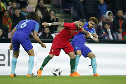 (L-R) Nathan Ake of Holland, Ricardo Quaresma of Portugal, Tonny Vilhena of Holland during the International friendly match match between Portugal and The Netherlands at Stade de Genève on March 26, 2018 in Geneva, Switzerland