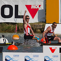 Stefan Holtz (R) and Tomasz Wylenzek (L) from Germany celebrate their victory in the C2 men Canoe 1000m final of the 2011 ICF World Canoe Sprint Championships held in Szeged, Hungary on August 20, 2011. ATTILA VOLGYI