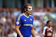 James Tarkowski of Brentford wearing a protection mask. Skybet football league championship match, Burnley  v Brentford at Turf Moor in Burnley, Lancs on Saturday 22nd August 2015.<br /> pic by Chris Stading, Andrew Orchard sports photography.