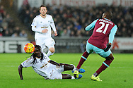 Bafetimbi Gomis of Swansea city © is tackled by Angelo Ogbonna of West Ham (r). Barclays Premier league match, Swansea city v West Ham Utd at the Liberty Stadium in Swansea, South Wales  on Sunday 20th December 2015.<br /> pic by  Andrew Orchard, Andrew Orchard sports photography.
