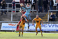 Newport county goalkeeper Joe Day jumps and claims the ball as Crawley Town player Matt Harold (9) jumps for a header. EFL Skybet football league two match, Newport county v Crawley Town at Rodney Parade in Newport, South Wales on Saturday 1st April 2017.<br /> pic by Andrew Orchard, Andrew Orchard sports photography.