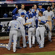 Kansas City Royals players celebrate as Christian Colon lines a base hit to left field to drive in Jarrod Dyson and give the Royals a 3-2 lead in the 12th inning during the New York Mets Vs Kansas City Royals, Game 5 of the MLB World Series at Citi Field, Queens, New York. USA. 1st November 2015. Photo Tim Clayton