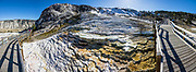 Mound Terrace boardwalks above Minerva Terrace, Mammoth Hot Springs. Yellowstone National Park, Wyoming, USA. This image was stitched from multiple overlapping photos.