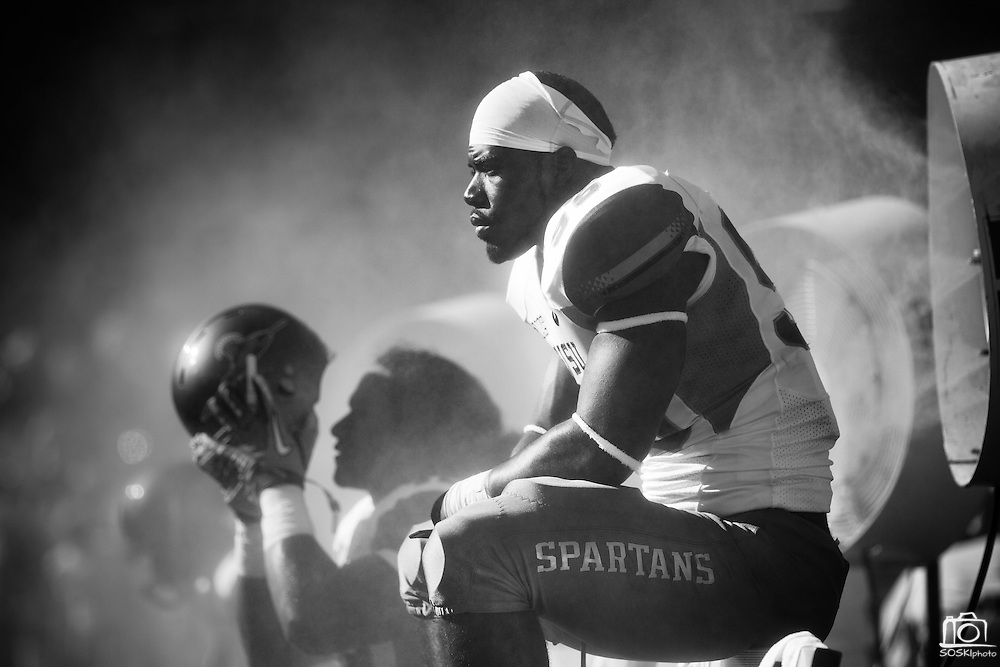 San Jose State's Sean Bacon (95) rest in front of a mist blower at Stanford University in Palo Alto, Calif., Sept. 3, 2011.  San Jose State lost the 2011 season opener to Stanford Unviersity (7), 57-3. (Spartan Daily/Stan Olszewski)