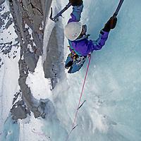 Ice climber Tim Villanueva (MR) leads steep up a steep frozen waterfall in Lee Vining Canyon, in California's Sierra Nevada.