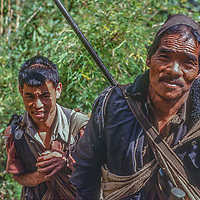 A hunter and his son in the foothills of Annapurna, Nepal.