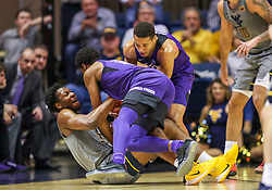Jan 14, 2020; Morgantown, West Virginia, USA; West Virginia Mountaineers forward Gabe Osabuohien (3) and TCU Horned Frogs forward Diante Smith (10) dive for a loose ball during the second half at WVU Coliseum. Mandatory Credit: Ben Queen-USA TODAY Sports