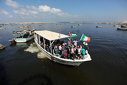 October 5, 2016 - Gaza City, Gaza Strip, Palestinian Territory - Palestinians show their solidarity with a Gaza-bound flotilla of international activists attempting to break the Israeli blockade on the Hamas-run Gaza Strip, on October 5, 2016 at the port in Gaza City. A group of women will try to reach the Gaza Strip on board a boat in a bid to break a decade-long blockade by Israel, a spokeswoman said. The flotilla dubbed ''Women's Boat to Gaza'', is part of the wider Freedom Flotilla Coalition that consists of pro-Palestinian boats that regularly go to Gaza from all over the world to try to break the blockade  (Credit Image: © Ashraf Amra/APA Images via ZUMA Wire)
