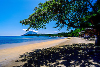 Indonesia, Sulawesi, Bunaken. Liang Beach with Manado Tua in the background.