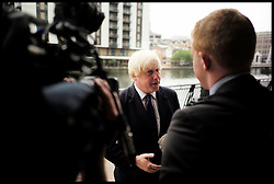 London Mayor Boris Johnson giving media interviews after giving a speech to urge London's small businesses to profit from the 2020 Games at the East Wintergarden, Canary Wharf, London, United Kingdom. Monday, 9th September 2013. Picture by Andrew Parsons / i-Images