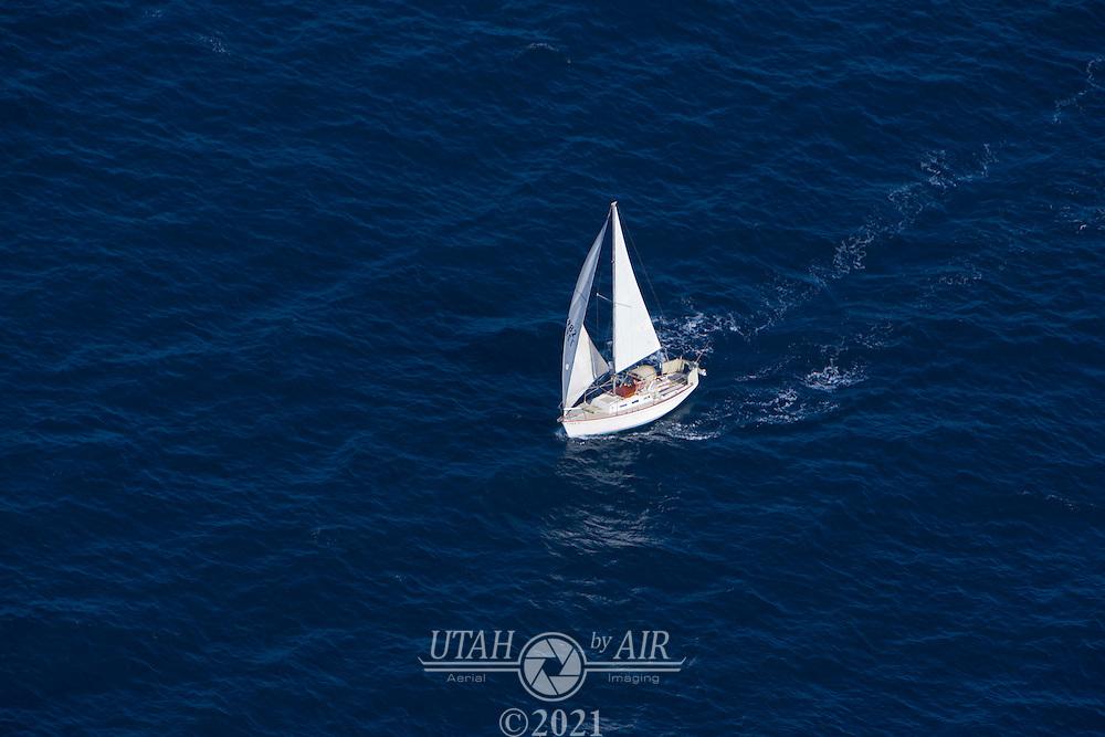 A lone sailboat off the coast of California
