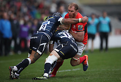 Saracens' Schalk Burger tackled by Sale Sharks' Mike Haley (15) and Sam Tuitupou (12) during the Aviva Premiership match at The AJ Bell Stadium, Sale.
