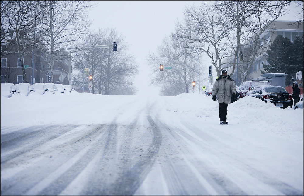 Walking down a isolated snow covered road in Midtown Kansas City, MO.