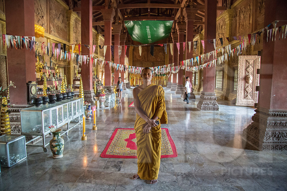 A Buddhist monk poses inside Prasat Phnom Reap, a newly constructed temple about 30 km Northwest of Phnom Penh City, Sangkat Ponsang, Phnom Penh, Cambodia