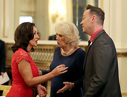 The Duchess of Cornwall, President of the National Osteoporosis Society, talks to 'Strictly Come Dancing' judges Shirley Ballas (left) and Craig Revel Horwood as she hosts a tea dance at Buckingham Palace in London attended by 'Strictly Come Dancing' dancers and judges to highlight the benefits for older people of staying active.