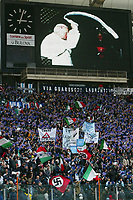 Fotball<br /> Serie A Italia 2004/05<br /> Lazio v Livorno<br /> 10. april 2005<br /> Foto: Digitalsport<br /> NORWAY ONLY<br /> Nazist flag in SS Lazio stand as screen shows an image of Pope Giovanni Paolo II