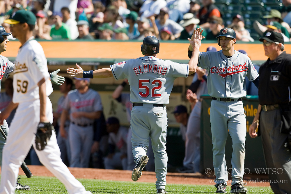 April 24, 2010; Oakland, CA, USA;  Cleveland Indians catcher Mike Redmond (52) celebrates with teammates after scoring a run against the Oakland Athletics during the ninth inning at Oakland-Alameda County Coliseum.  Cleveland defeated Oakland 6-1.