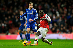 Arsenal Defender Bacary Sagna (FRA) passes as Chelsea Forward Andre Schurrle (GER) challenges during the second half of the match - Photo mandatory by-line: Rogan Thomson/JMP - Tel: Mobile: 07966 386802 - 23/12/2013 - SPORT - FOOTBALL - Emirates Stadium - Arsenal v Chelsea - Barclays Premier League.