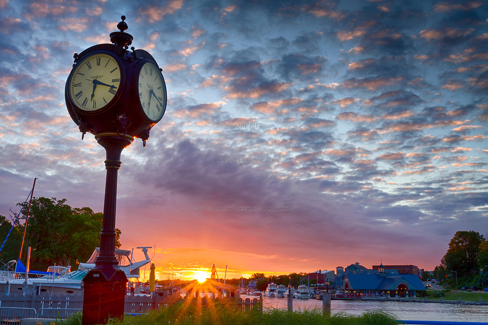 Clock on the banks of the Black River in South Haven keeps pace as the sun rises.
