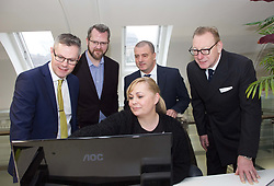 Finance Secretary Derek Mackay, far left, is shown the work going on at The ID Co offices by employee Mary Thornberry, with (from left) James Varga, CEO and co-founder The ID Co; Steve Dunlop, CEO Scottish Enterprise and Benny Higgins, strategic adviser to the First Minister on setting up the bank. pic by Terry Murden @edinburghelitemedia