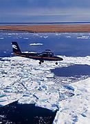 Cape Smythe Air's de Havilland DHC6 Twin Otter on ice reconnaissance flight over the Arctic Ocean between Barrow and Wainwright, Alaska.