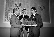 21/05/1966<br /> 05/21/1966<br /> 21 May 1966<br /> Castrol (Ireland) Ltd. presentation of Castrol Trophy to Home Farm football team at the Central Hotel, Dublin. Replicas were presented to each of the players and Drumcondra, who were runners-up received medals. Picture shows Mr. Leonard A. Courtney, Managing Director of Castrol (Ireland) Ltd. presenting the Castrol Trophy to Jerry James, Captain of Home Farm. Centre is P. McGrath, Captain, Drumcondra team.