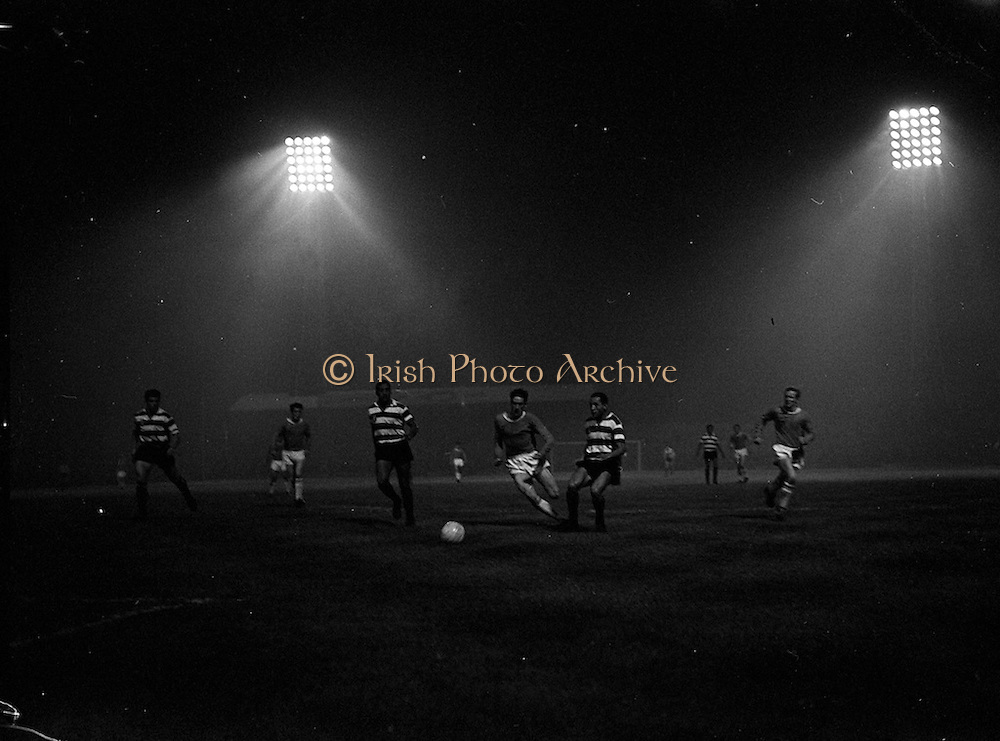 19/09/1962<br /> 09/19/1962<br /> 19 September 1962<br /> Soccer: Sporting Clube de Portugal (Sporting Lisbon) v Shelbourne, European Cup, at Dalymount Park. The game ended 2-0 to Sporting. Jackie Hennessy advances watched by Luciot Hilario.