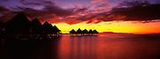 Sunrise image of overwater bungalows at the Intercontinental Le Moana Resort on Bora Bora, Tahiti, French Polynesia by Randy Wells